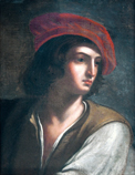 A young man with a red beret cap